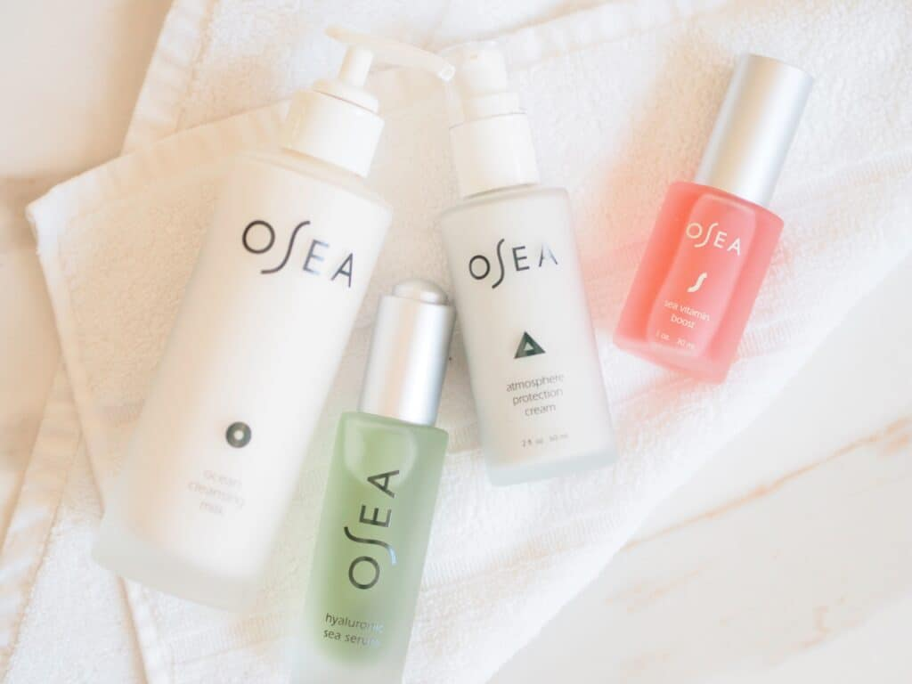Osea products for glowing summer skin on a white cloth on a table
