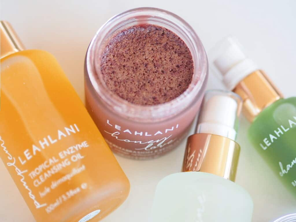 Leahlani Skincare Honey Love and cleansing oil open on counter for brand review