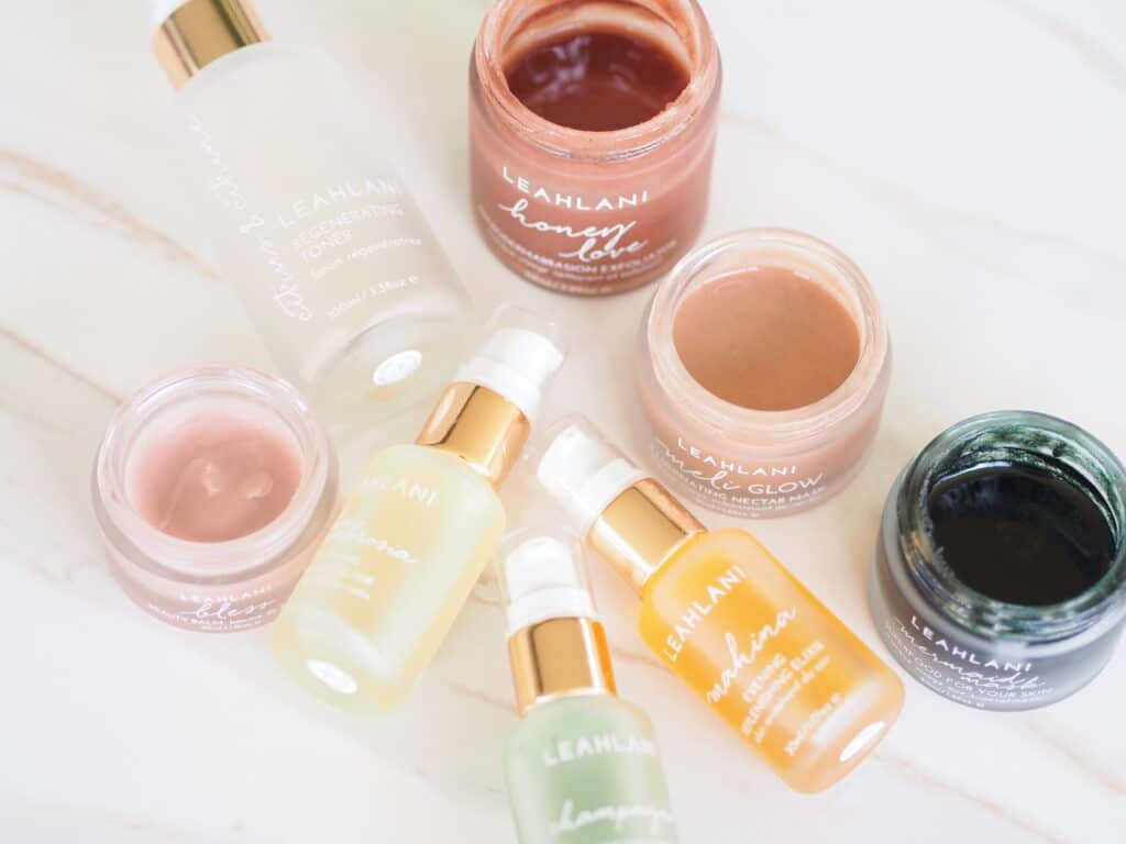Delilah's Favorite Clean Skincare Products Of 2019 includes Leahlani Skincare line displayed here with open jars on counter
