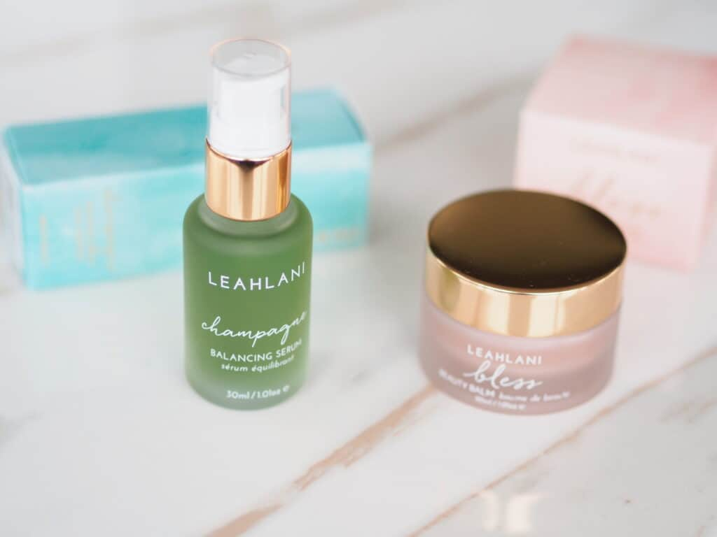Leahlani Skincare Champagne serum and Happy Hour serum on counter for product review