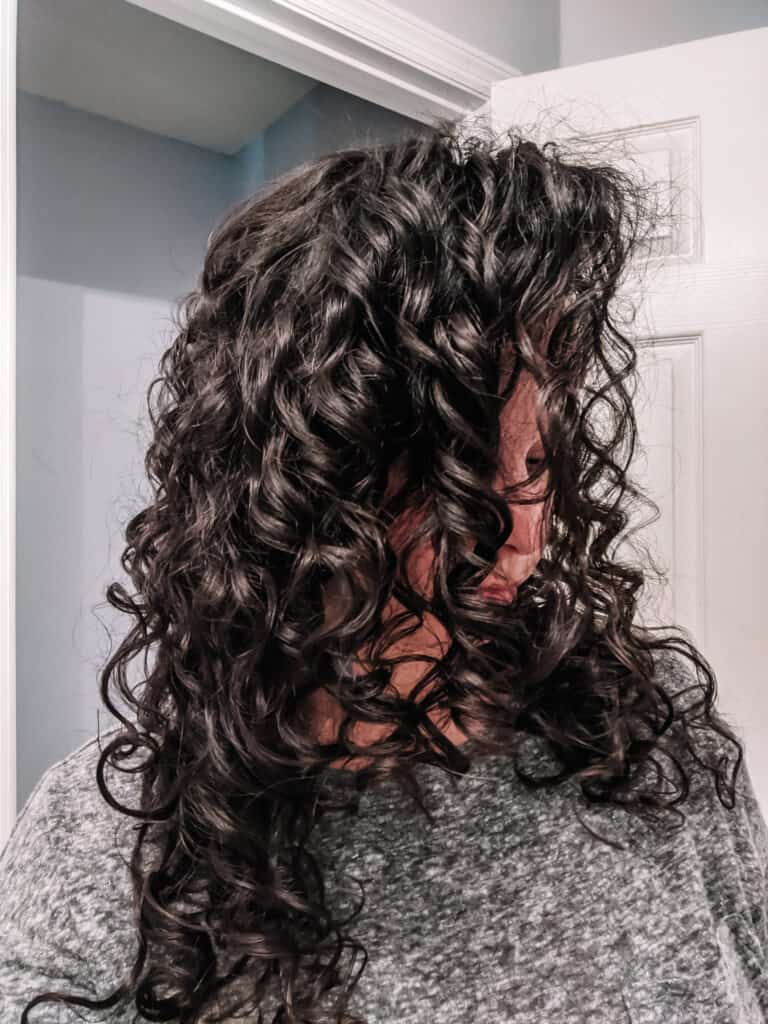 Side view of flaxseed gel results on Delilah's curly hair