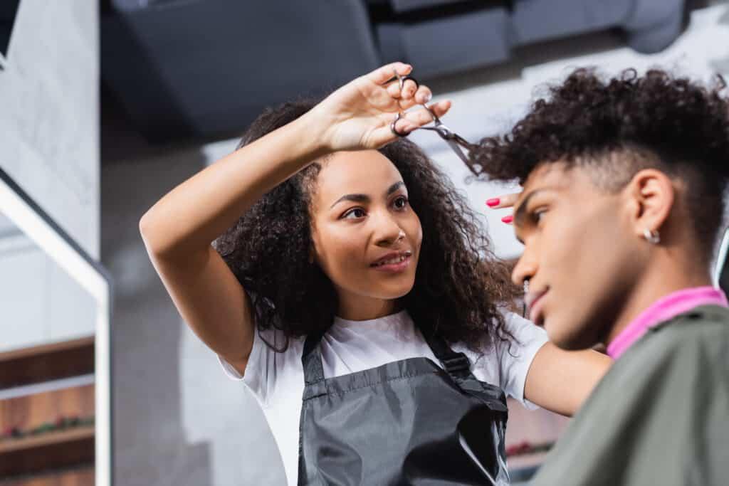 curly hair cut stylist working