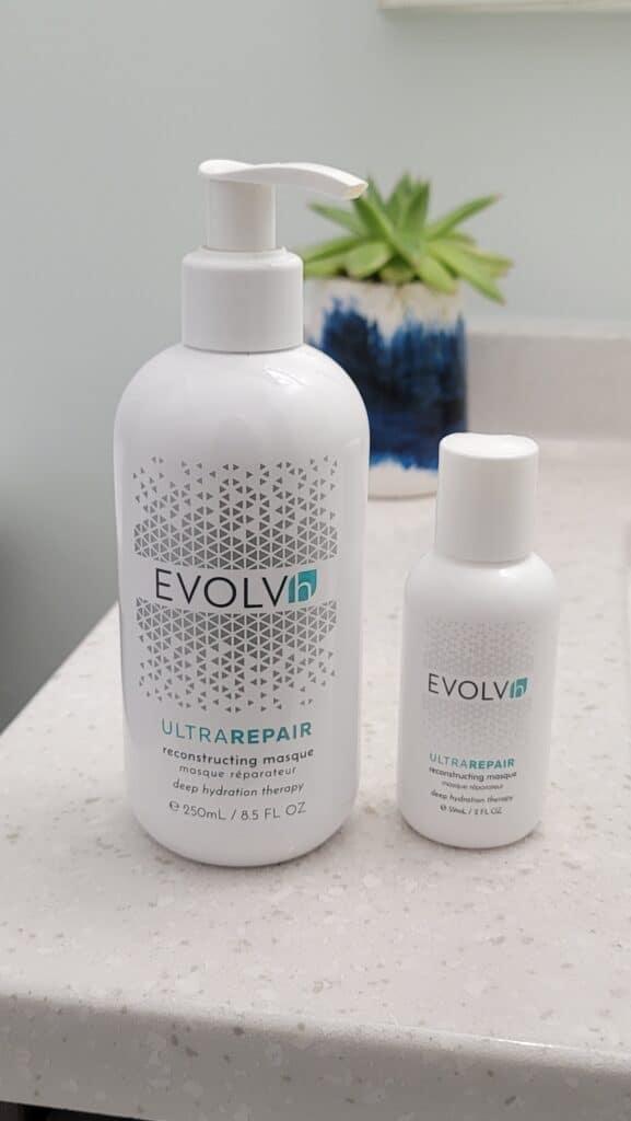 bottles of EVOLVh UltraRepair Reconstructin Masque